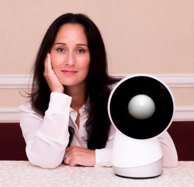 Cynthia Breazeal with the robot she made